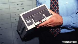 Man holding safety deposit box