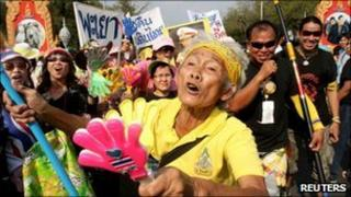 A supporter of the People's Alliance for Democracy (PAD) gestures during a rally outside the Government House in Bangkok