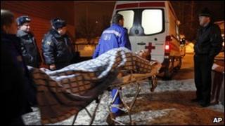 A blast victim is taken to hospital, 24 Jan 11