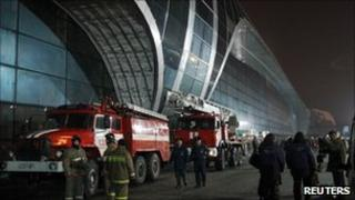 Fire crews at the airport in Moscow