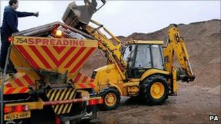 Lorry loading grit at council depot