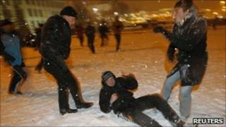 A plain-clothes policeman beats a protester in Minsk (20 Dec 2010)