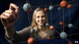 Student Isobel Marr, 23, with the molecular model of common salt, made from balls of wool and knitting needles