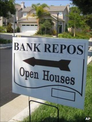Sign advertising a bank-repossessed home for sale in San Clemente, California