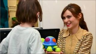Sophie Ellis-Bextor with a child at the Chelsea and Westminster Hospital