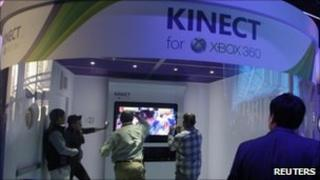 A Microsoft booth featuring the Kinect controller