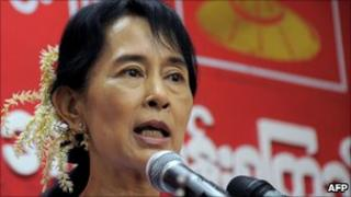 Aung San Suu Kyi speaks to young people at the headquarters of the disbanded NLD party in Rangoon