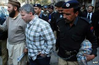 Pakistani police escort US national Raymond Davis (centre) to a court in Lahore on 28 January 2011