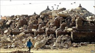 A man walks past the debris of a historical religious monument that collapsed in Bhuj town in Gujarat in January 2001