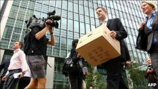A Lehman Brothers worker removes his belongings after the firm folded in autumn 2008