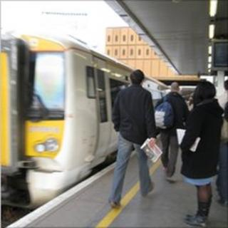 Commuters about to board a train at London Bridge Station, London