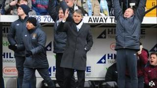 Roberto Mancini on the Manchester City bench at Notts County