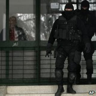 Members of Serbia's anti-terrorist unit secure the area in front of a building in which Darko Mladic's apartment is located