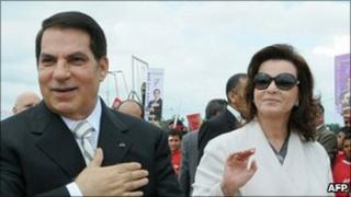 Ousted Tunisian President Zine al-Abidine Ben Ali (l) and his wife Leila