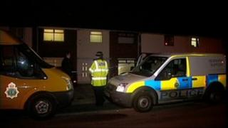 The scene outside the house in Banbury Avenue, Halewood on Monday evening