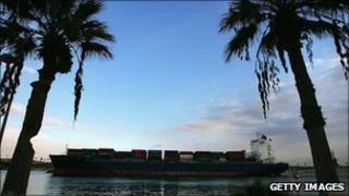 An international cargo ship passes through the Suez Canal (file photo)