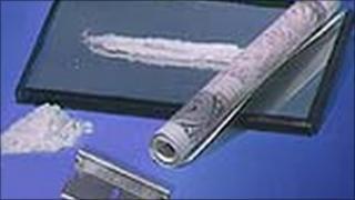 Cocaine, bank note and razor