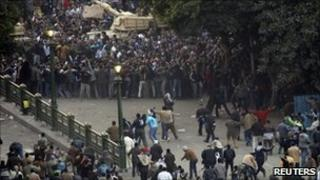 Supporters and opponents of Egypt's President Hosni Mubarak clash in Cairo's Tahrir Square - 2 February 2011