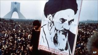 A poster of Ayatollah Khomeini at an anti-Shah demonstration in Tehran in December 1978