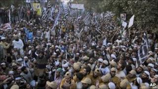 Supporters of Pakistani religious parties take part in a rally to protest against any attempt to modify the blasphemy laws