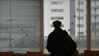 Man against window in silhouette