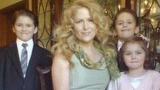 Theresa Riggi with Cecilia and twins Luke and Austin.