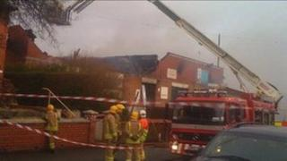 Firefighters at the damaged Shotton Lane Social Club