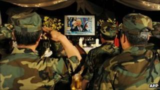 Hmong veterans salute a portrait of Gen Vang Pao at his funeral in Fresco, CA (4 Feb 2011)