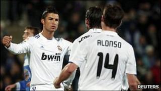 "Real Madrid""s Cristiano Ronaldo (l) celebrates a goal with his team-mates Sergio Ramos and Xabi Alonso"