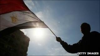 Protester waves Egyptian flag