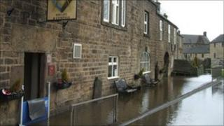 Square and Compass pub during floods