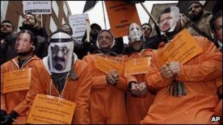 Islamic supporters wearing face masks of Arab countries leaders demonstrate in London