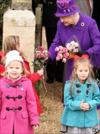 The Queen accepted flower from children after the service