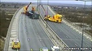 Overturned lorry on M60