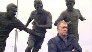 Sir Geoff Hurst visits his statue in Ashton-under-Lyne
