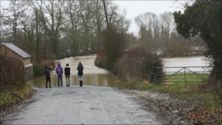 Roads were flooded in the Maesbrook and Melverley areas