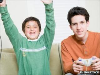 Boy and babysitter play computer games (Posed by model)