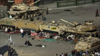Protesters camped around tanks, Tahrir Square, Cairo (9 February 2011)