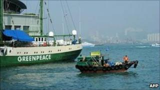 Greenpeace Rainbow Warrior (back L) visits Hong Kong on February 9, 2011