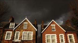 Houses under black sky