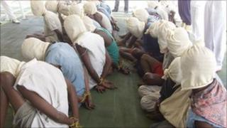 Somali pirates captured in Indian ocean were paraded with their faces covered