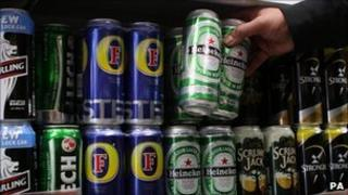 Cans of lager in a shop - generic
