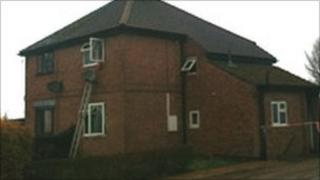 The woman was rescued from a bedroom window