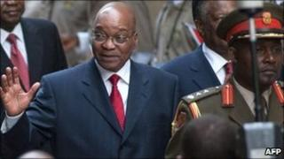 South African President Jacob Zuma waves as he arrives to deliver a state of the nation speech at the parliament in Cape Town on 10 February 2011
