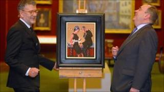 Jack Vettriano and Alex Salmond with the painting used on the Christmas card