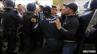 Algerian riot police push back anti-government protesters in Algiers - 12 February 2011