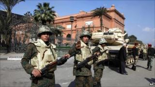 Soldiers guard the Egyptian Museum. Photo: 12 February 2011