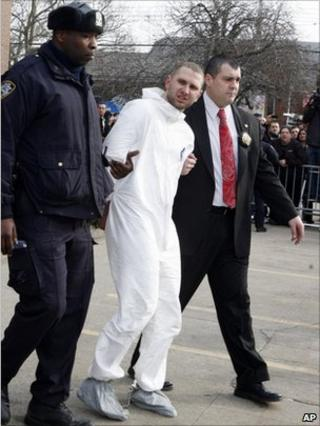 Maksim Gelman, escorted by police in Brooklyn, NY 13 February 2011