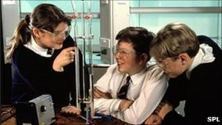 Pupils observe electrolysis of water during science lesson