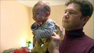 Oleg Tyutin and baby Pavel